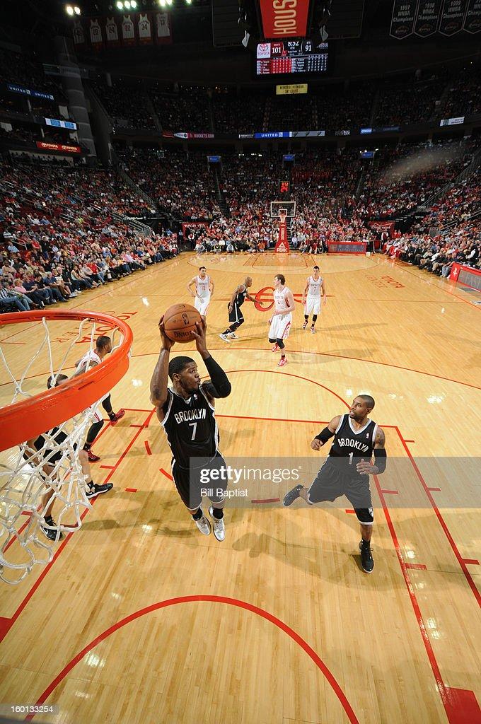 Joe Johnson #7 of the Brooklyn Nets grabs a rebound against the Brooklyn Nets on January 26, 2013 at the Toyota Center in Houston, Texas.