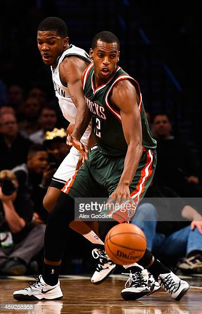 Joe Johnson of the Brooklyn Nets guards Khris Middleton of the Milwaukee Bucks in the fourth quarter at the Barclays Center on November 19 2014 in...