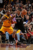 Joe Johnson of the Brooklyn Nets handles the ball against LeBron James of the Cleveland Cavaliers on March 18 2015 at Quicken Loans Arena in...