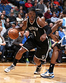 Joe Johnson of the Brooklyn Nets handles the ball against the Minnesota Timberwolves on March 16 2015 at Target Center in Minneapolis Minnesota NOTE...