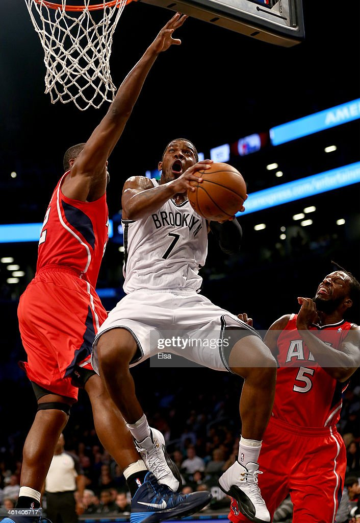 Joe Johnson #7 of the Brooklyn Nets heads for the net as <a gi-track='captionPersonalityLinkClicked' href=/galleries/search?phrase=Elton+Brand&family=editorial&specificpeople=201501 ng-click='$event.stopPropagation()'>Elton Brand</a> #42 and <a gi-track='captionPersonalityLinkClicked' href=/galleries/search?phrase=DeMarre+Carroll&family=editorial&specificpeople=784686 ng-click='$event.stopPropagation()'>DeMarre Carroll</a> #5 of the Atlanta Hawks defend at the Barclays Center on January 6, 2014 in the Brooklyn borough of New York City.The Brooklyn Nets defeated the Atlanta Hawks 91-86.