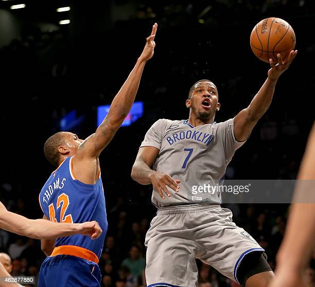 Joe Johnson of the Brooklyn Nets heads for the net as Lance Thomas of the New York Knicks defends at the Barclays Center on February 6 2015 in the...