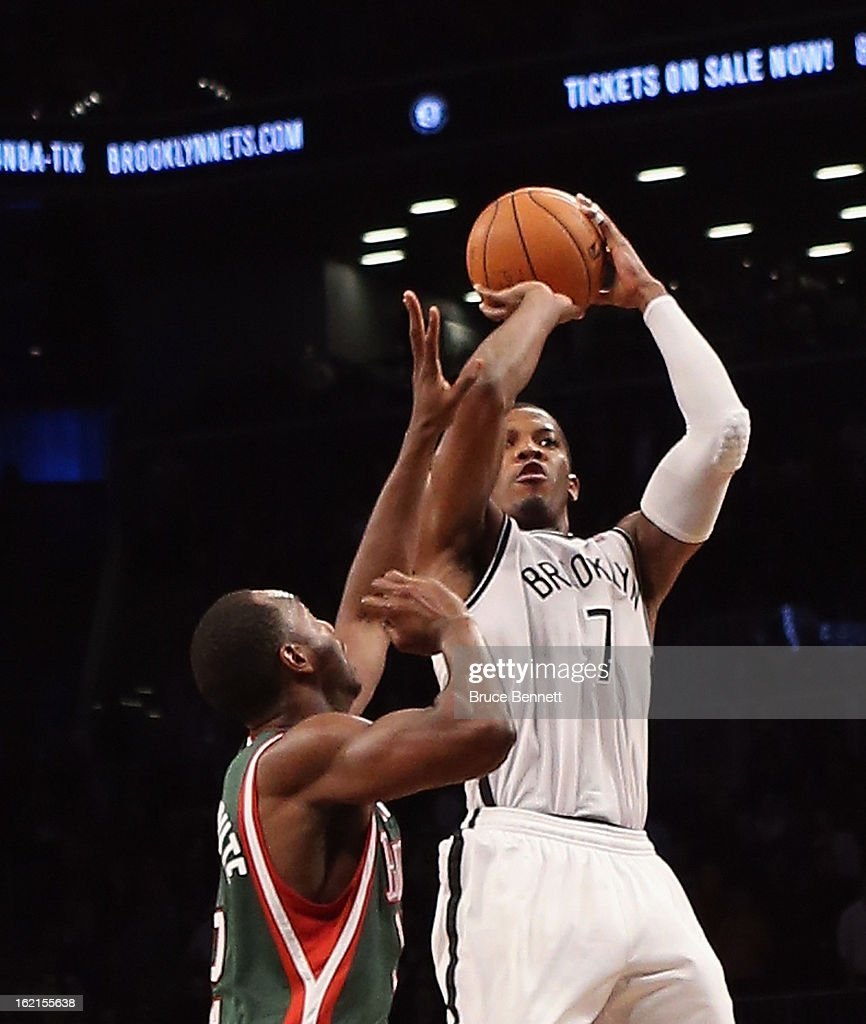 <a gi-track='captionPersonalityLinkClicked' href=/galleries/search?phrase=Joe+Johnson+-+Basketball+Player&family=editorial&specificpeople=201652 ng-click='$event.stopPropagation()'>Joe Johnson</a> #7 of the Brooklyn Nets hits a basket with 1.2 seconds remaining in overtime to defeat the Milwaukee Bucks 113-111 at the Barclays Center on February 19, 2013 in New York City.