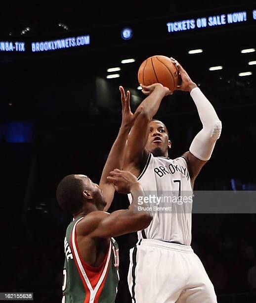 Joe Johnson of the Brooklyn Nets hits a basket with 12 seconds remaining in overtime to defeat the Milwaukee Bucks 113111 at the Barclays Center on...