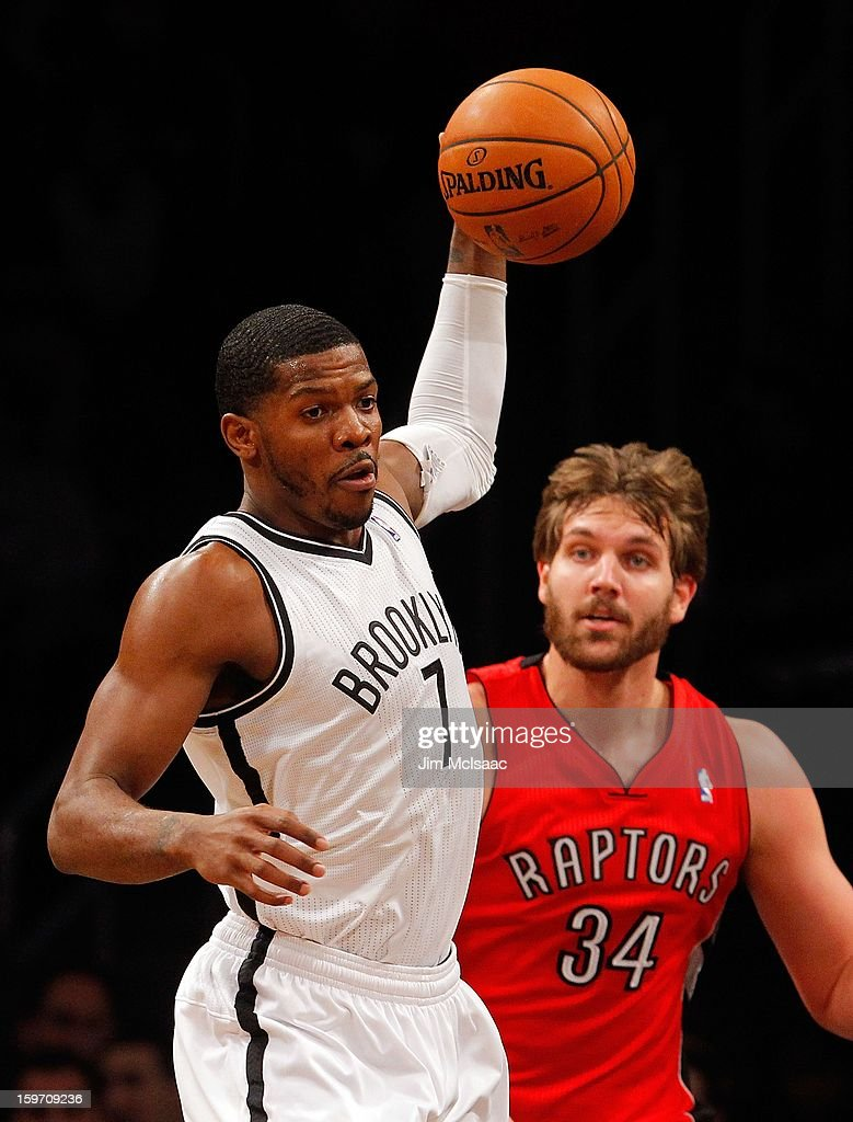 Joe Johnson #7 of the Brooklyn Nets in action against Aaron Gray #34 of the Toronto Raptors at Barclays Center on January 15, 2013 in the Brooklyn borough of New York City.The Nets defeated the Raptors 113-106.