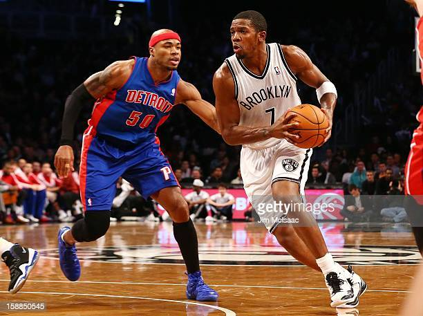 Joe Johnson of the Brooklyn Nets in action against Corey Maggette of the Detroit Pistons at Barclays Center on December 14 2012 in the Brooklyn...