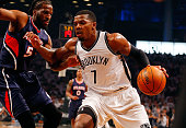 Joe Johnson of the Brooklyn Nets in action against DeMarre Carroll of the Atlanta Hawks during game six in the first round of the 2015 NBA Playoffs...