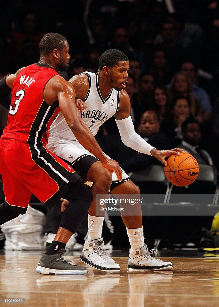 Joe Johnson #7 of the Brooklyn Nets in action against Dwyane Wade #3 of the Miami Heat at Barclays Center on January 30, 2013 in the Brooklyn borough of New York City.The Heat defeated the Nets 105-85.