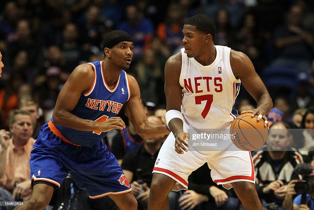Joe Johnson #7 of the Brooklyn Nets in action against James White #4 of the New York Knicks during a preseason game at Nassau Coliseum on October 24 2012 in Uniondale, New York The Knicks defeated the Nets 97-95.