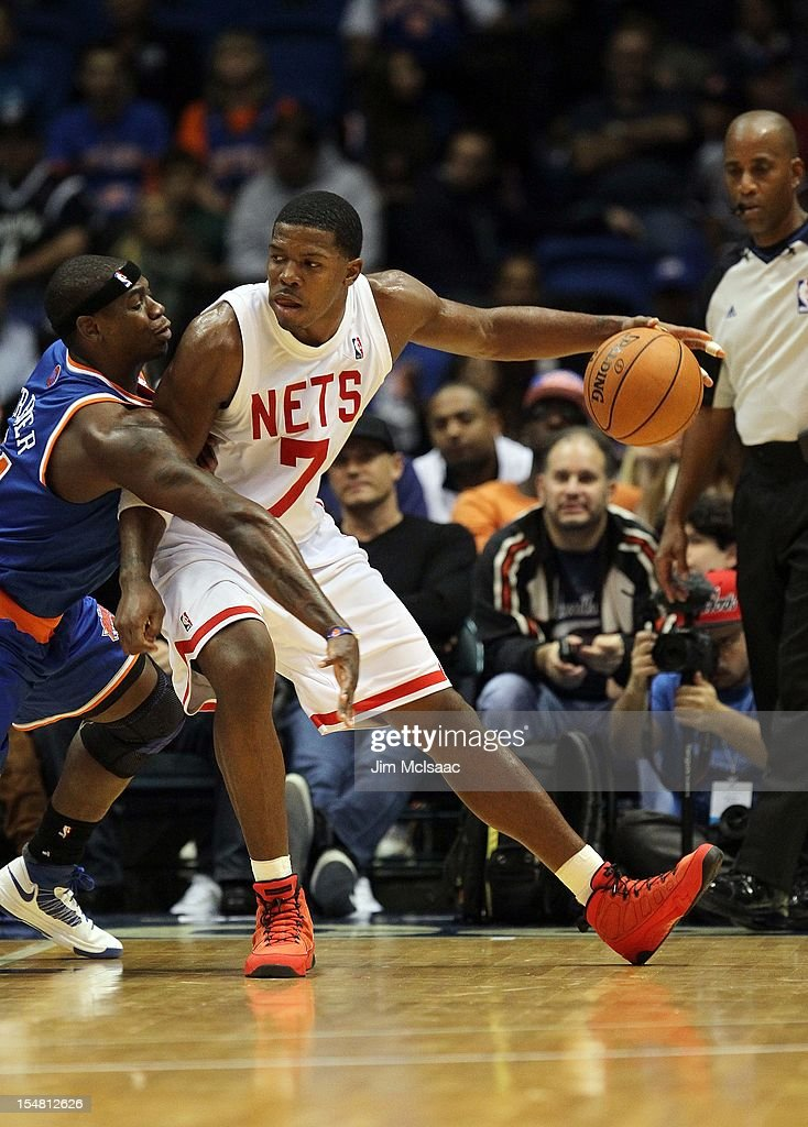 Joe Johnson #7 of the Brooklyn Nets in action against Ronnie Brewer #11 of the New York Knicks during a preseason game at Nassau Coliseum on October 24 2012 in Uniondale, New York The Knicks defeated the Nets 97-95.