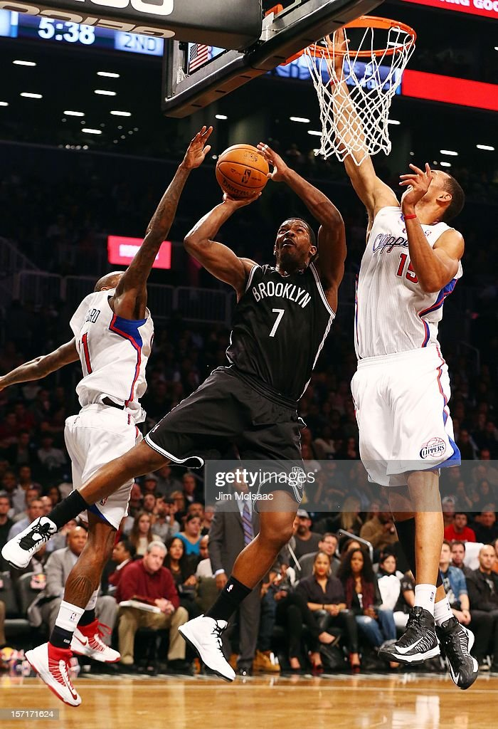 Joe Johnson #7 of the Brooklyn Nets in action against Ryan Hollins #15 and Jamal Crawford #11 of the Los Angeles Clippers at Barclays Center on November 23, 2012 in the Brooklyn borough of New York City.The Nets defeated the Clippers 86-76.