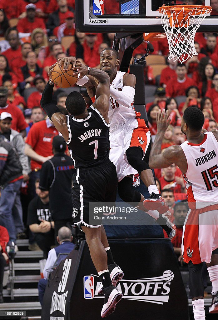 Joe Johnson #7 of the Brooklyn Nets is denied by Terrence Ross #31 of the Toronto Raptors in Game Seven of the NBA Eastern Conference Quarterfinals at the Air Canada Centre on May 4, 2014 in Toronto, Ontario, Canada. The Nets defeated the Raptors 114-113 to win the series 4-3.