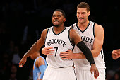 Joe Johnson of the Brooklyn Nets is embraced by Brook Lopez after Johnson scored a basket in the first half against the Denver Nuggets at the...