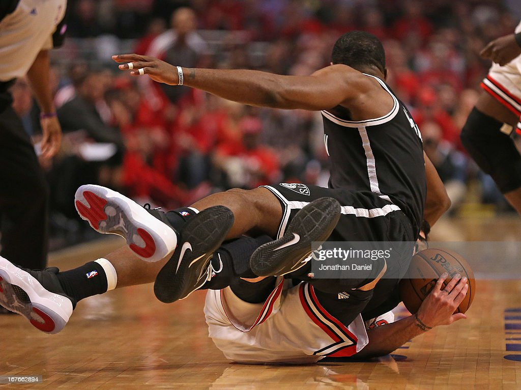 <a gi-track='captionPersonalityLinkClicked' href=/galleries/search?phrase=Joe+Johnson+-+Jugador+de+baloncesto&family=editorial&specificpeople=201652 ng-click='$event.stopPropagation()'>Joe Johnson</a> #7 of the Brooklyn Nets lands on top of <a gi-track='captionPersonalityLinkClicked' href=/galleries/search?phrase=Kirk+Hinrich&family=editorial&specificpeople=201629 ng-click='$event.stopPropagation()'>Kirk Hinrich</a> #12 of the Chicago Bulls in Game Five of the Eastern Conference Quarterfinals in the 2013 NBA Playoffs at the United Center on April 27, 2013 in Chicago, Illinois.