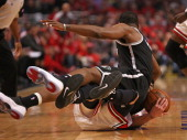 Joe Johnson of the Brooklyn Nets lands on top of Kirk Hinrich of the Chicago Bulls in Game Five of the Eastern Conference Quarterfinals in the 2013...