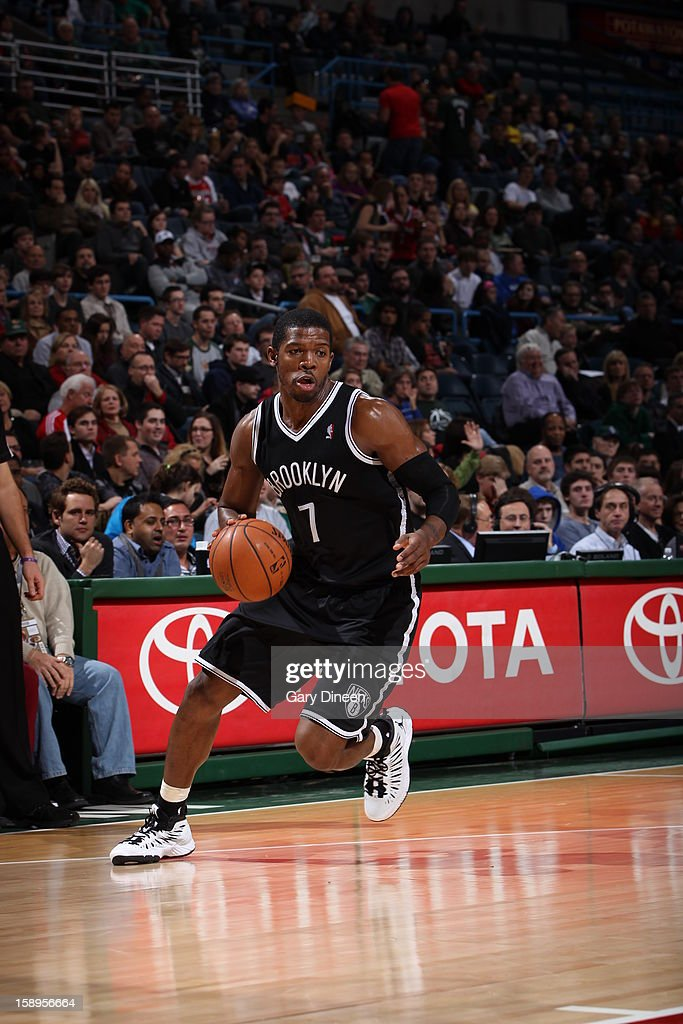 <a gi-track='captionPersonalityLinkClicked' href=/galleries/search?phrase=Joe+Johnson+-+Basketballer&family=editorial&specificpeople=201652 ng-click='$event.stopPropagation()'>Joe Johnson</a> #7 of the Brooklyn Nets looks to drive to the basket against the Milwaukee Bucks on December 26, 2012 at the BMO Harris Bradley Center in Milwaukee, Wisconsin.