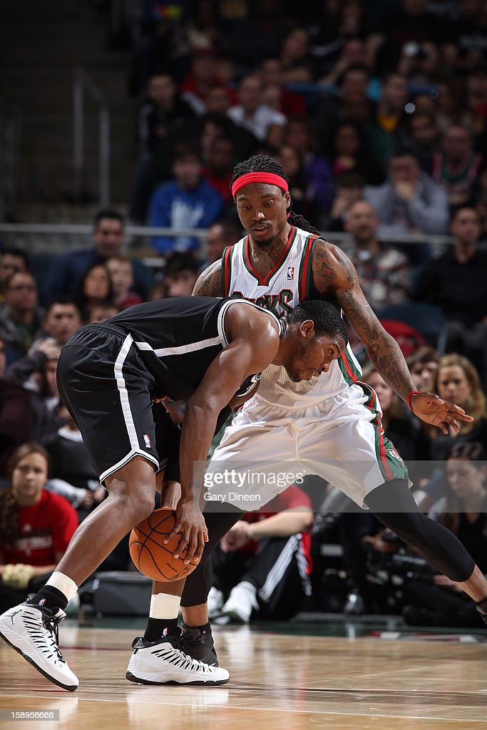 <a gi-track='captionPersonalityLinkClicked' href=/galleries/search?phrase=Joe+Johnson+-+Basketball+Player&family=editorial&specificpeople=201652 ng-click='$event.stopPropagation()'>Joe Johnson</a> #7 of the Brooklyn Nets looks to drive to the basket against <a gi-track='captionPersonalityLinkClicked' href=/galleries/search?phrase=Marquis+Daniels&family=editorial&specificpeople=202465 ng-click='$event.stopPropagation()'>Marquis Daniels</a> #6 of the Milwaukee Bucks on December 26, 2012 at the BMO Harris Bradley Center in Milwaukee, Wisconsin.