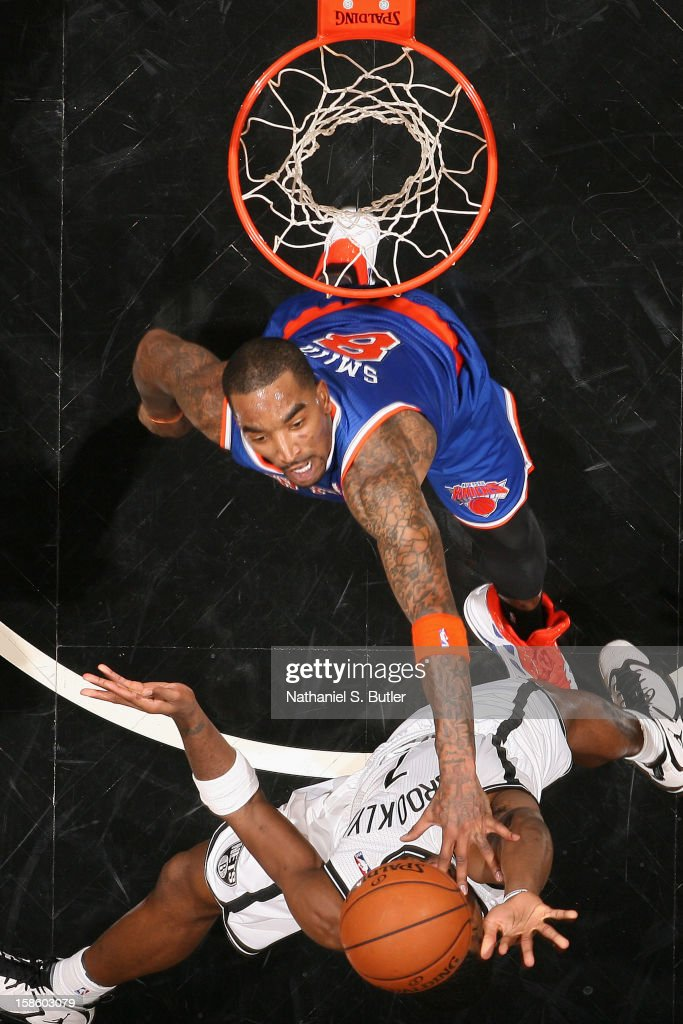 Joe Johnson #7 of the Brooklyn Nets looks to grab a rebound over J.R. Smith #8 of the New York Knicks on December 11, 2012 at the Barclays Center in the Brooklyn borough of New York City.