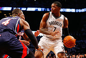 Joe Johnson of the Brooklyn Nets looks to make a play as he is defended by Paul Millsap and Jeff Teague of the Atlanta Hawks during game six in the...