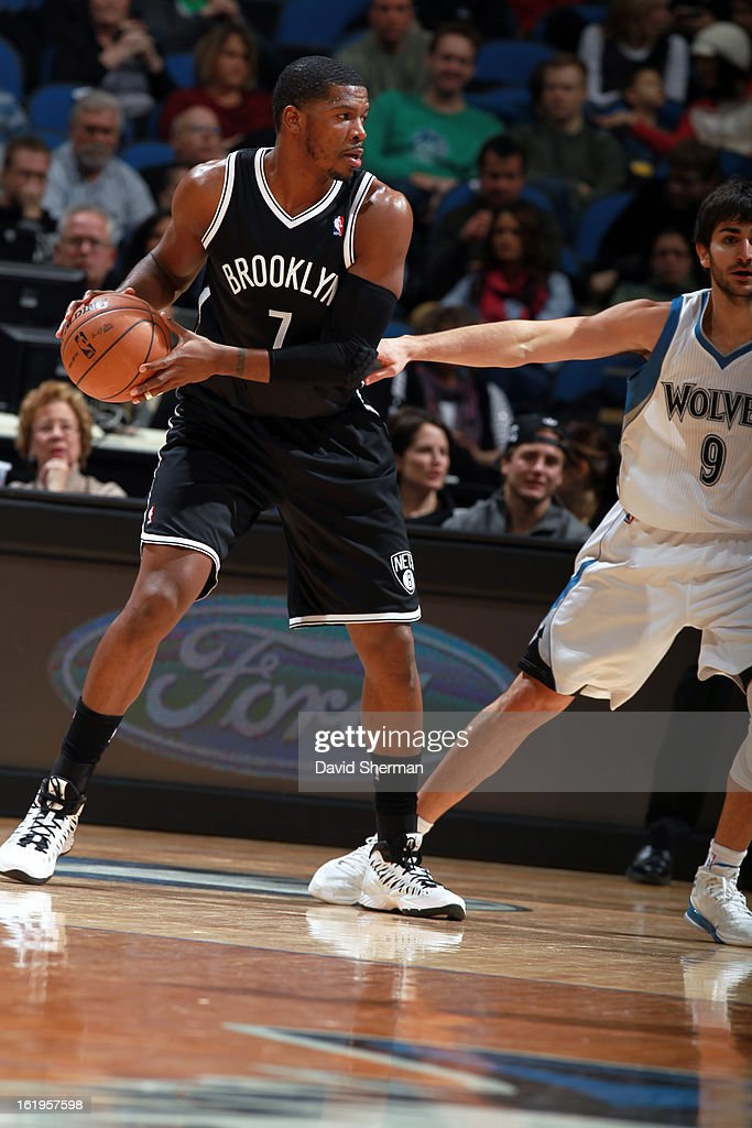 <a gi-track='captionPersonalityLinkClicked' href=/galleries/search?phrase=Joe+Johnson+-+Basketball+Player&family=editorial&specificpeople=201652 ng-click='$event.stopPropagation()'>Joe Johnson</a> #7 of the Brooklyn Nets looks to pass the ball against the Minnesota Timberwolves on January 23, 2013 at Target Center in Minneapolis, Minnesota.