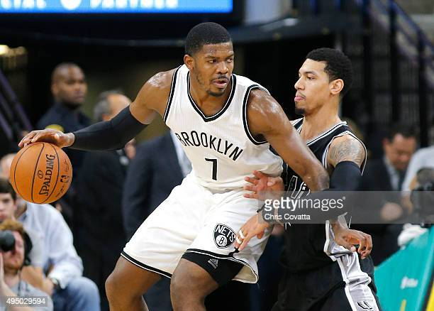 Joe Johnson of the Brooklyn Nets moves with the ball against Danny Green of the San Antonio Spurs at the ATT Center on October 30 2015 in San Antonio...