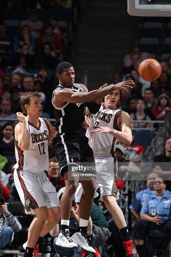 <a gi-track='captionPersonalityLinkClicked' href=/galleries/search?phrase=Joe+Johnson+-+Basketball+Player&family=editorial&specificpeople=201652 ng-click='$event.stopPropagation()'>Joe Johnson</a> #7 of the Brooklyn Nets passes the ball against the Milwaukee Bucks on December 26, 2012 at the BMO Harris Bradley Center in Milwaukee, Wisconsin.