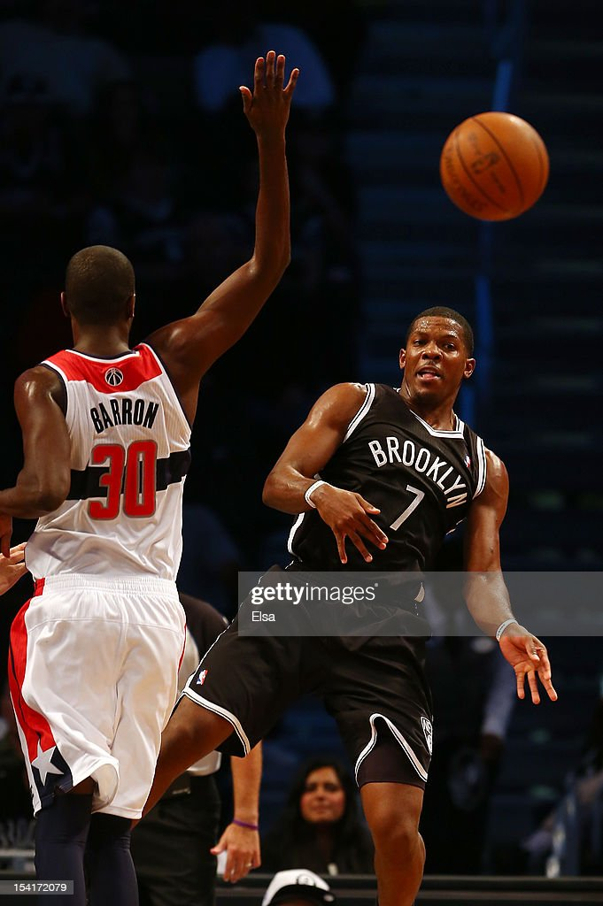 Joe Johnson #7 of the Brooklyn Nets passes the ball as Earl Barron #30 of the Washington Wizards defends during a preseason game at the Barclays Center on October 15, 2012 in the Brooklyn borough of New York City.
