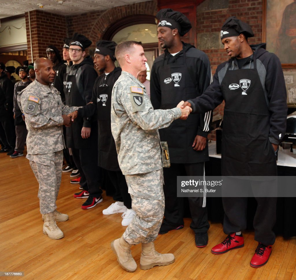 Joe Johnson #7 of the Brooklyn Nets poses for a picture during a team event in celebration of Veterans Day at Ft. Hamilton, Brooklyn on November 11, 2013 in the Brooklyn borough of New York City.