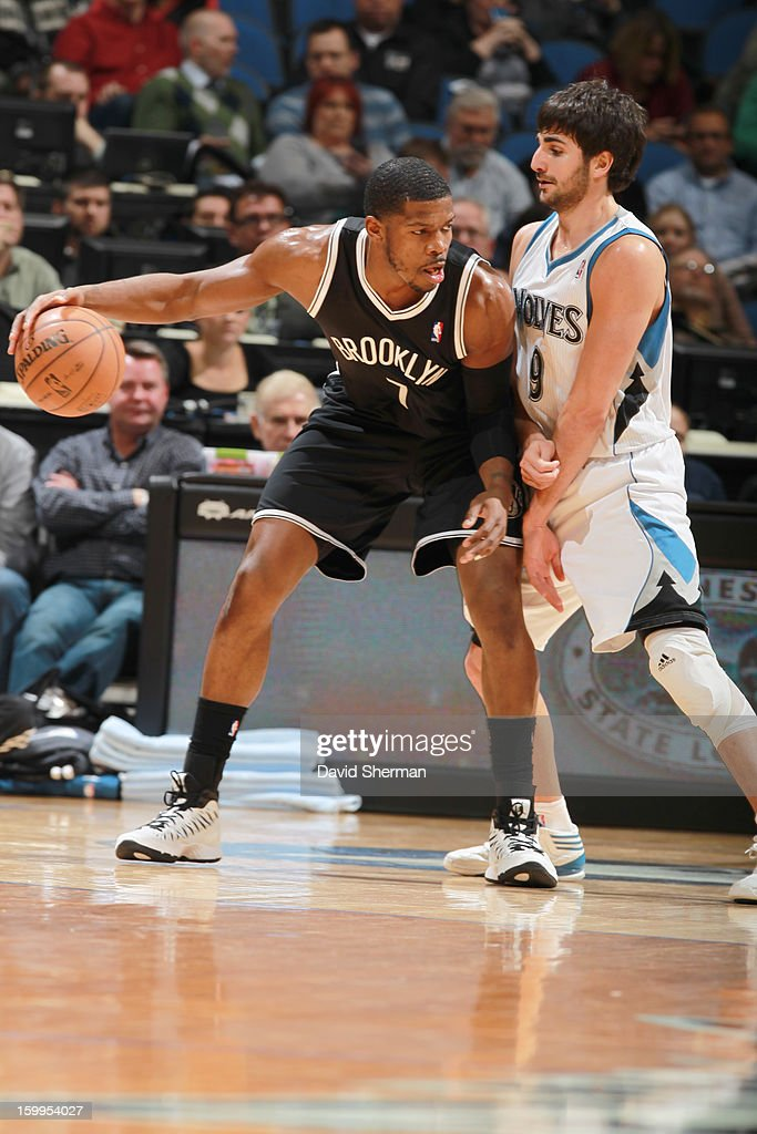 Joe Johnson #7 of the Brooklyn Nets protects the ball from Ricky Rubio #9 of the Minnesota Timberwolves during the game between the Minnesota Timberwolves and the Brooklyn Nets on January 23, 2013 at Target Center in Minneapolis, Minnesota.