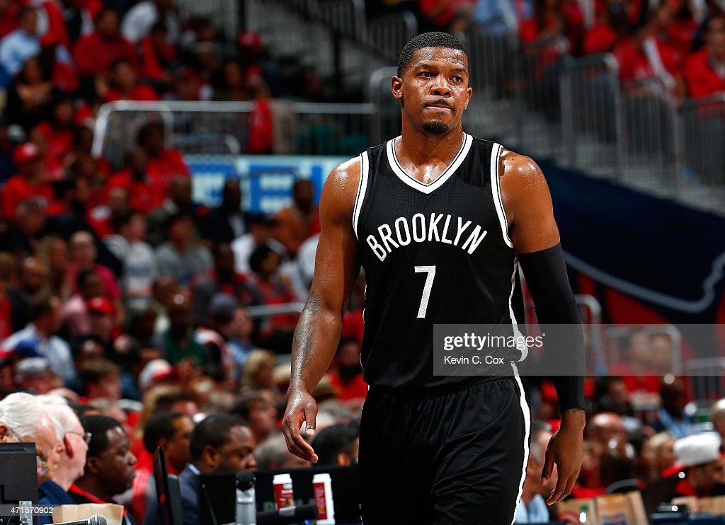 Joe Johnson of the Brooklyn Nets reacts as he walks to the bench during Game Five of the Eastern Conference Quarterfinals of the NBA Playoffs against...