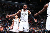 Joe Johnson of the Brooklyn Nets shakes hands with his teammates during the game against the Charlotte Hornets on February 21 2016 at Barclays Center...