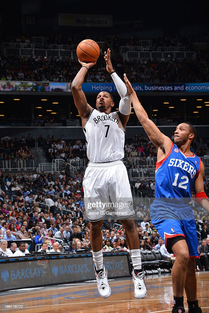 Joe Johnson #7 of the Brooklyn Nets shoots a jumper against Evan Turner #12 of the Philadelphia 76ers on April 9, 2013 at the Barclays Center in Brooklyn, New York.