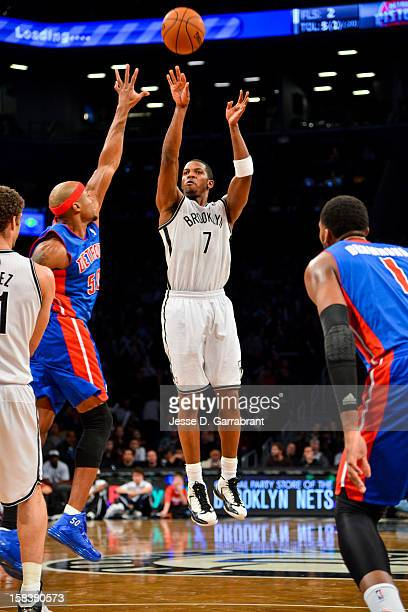Joe Johnson of the Brooklyn Nets shoots a threepointer against Corey Maggette of the Detroit Pistons at the Barclays Center on December 14 2012 in...
