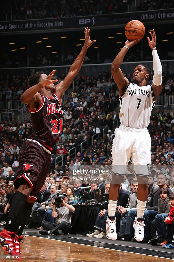 Joe Johnson #7 of the Brooklyn Nets shoots a three-pointer against Jimmy Butler #21 of the Chicago Bulls on April 4, 2013 at the Barclays Center in the Brooklyn borough of New York City.