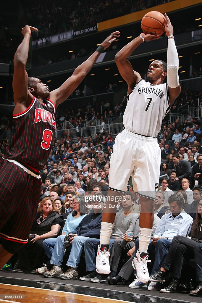 Joe Johnson #7 of the Brooklyn Nets shoots a three-pointer against Luol Deng #9 of the Chicago Bulls on April 4, 2013 at the Barclays Center in the Brooklyn borough of New York City.