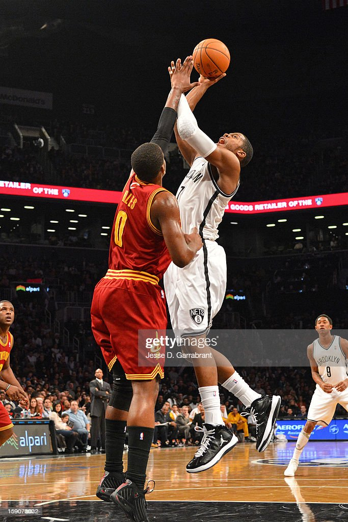 Joe Johnson #7 of the Brooklyn Nets shoots against C.J. Miles #0 of the Cleveland Cavaliers at the Barclays Center on December 29, 2012 in Brooklyn, New York.
