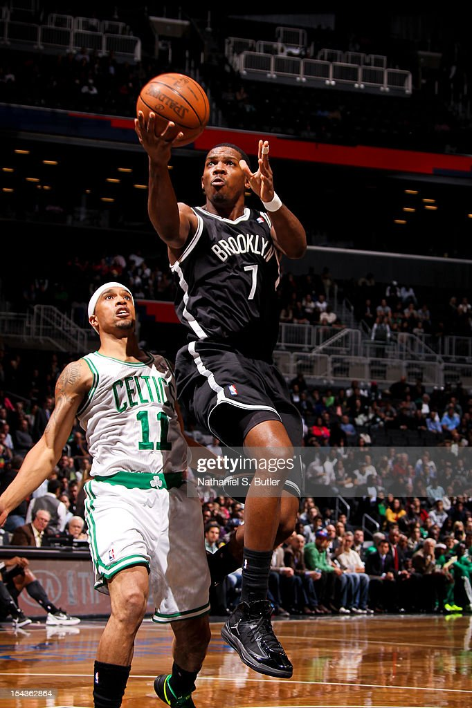 Joe Johnson #7 of the Brooklyn Nets shoots against Courtney Lee #11 of the Boston Celtics during a pre-season game on October 18, 2012 at the Barclays Center in the Brooklyn borough of New York City.