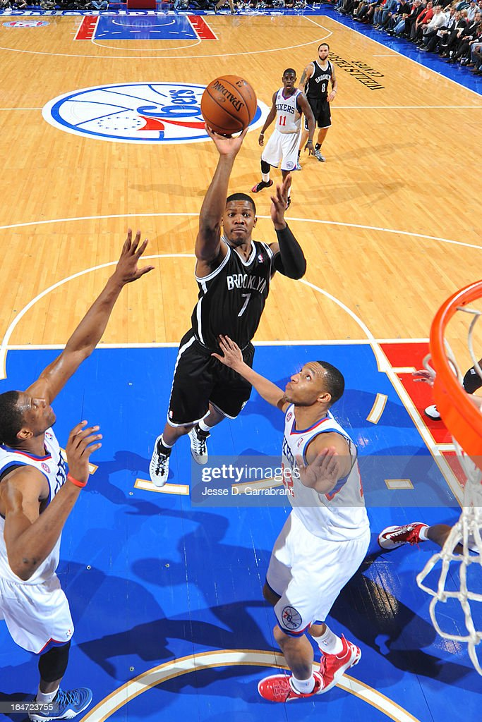 Joe Johnson #7 of the Brooklyn Nets shoots against Evan Turner #12 of the Philadelphia 76ers at the Wells Fargo Center on March 11, 2013 in Philadelphia, Pennsylvania.