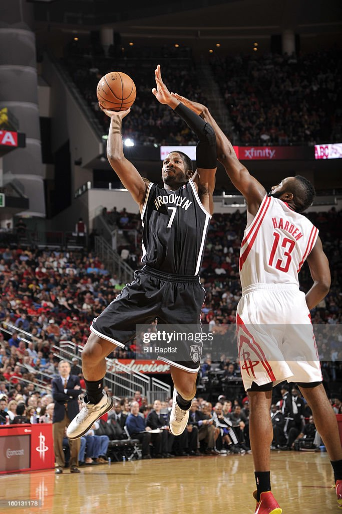 Joe Johnson #7 of the Brooklyn Nets shoots against James Harden #13 of the Houston Rockets on January 26, 2013 at the Toyota Center in Houston, Texas.