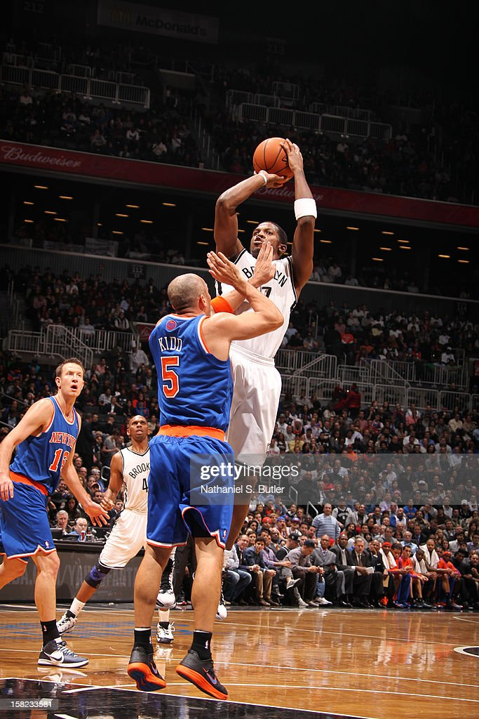 Joe Johnson #7 of the Brooklyn Nets shoots against Jason Kidd #5 of the New York Knicks December 11, 2012 at the Barclays Center in the Brooklyn borough of New York City.