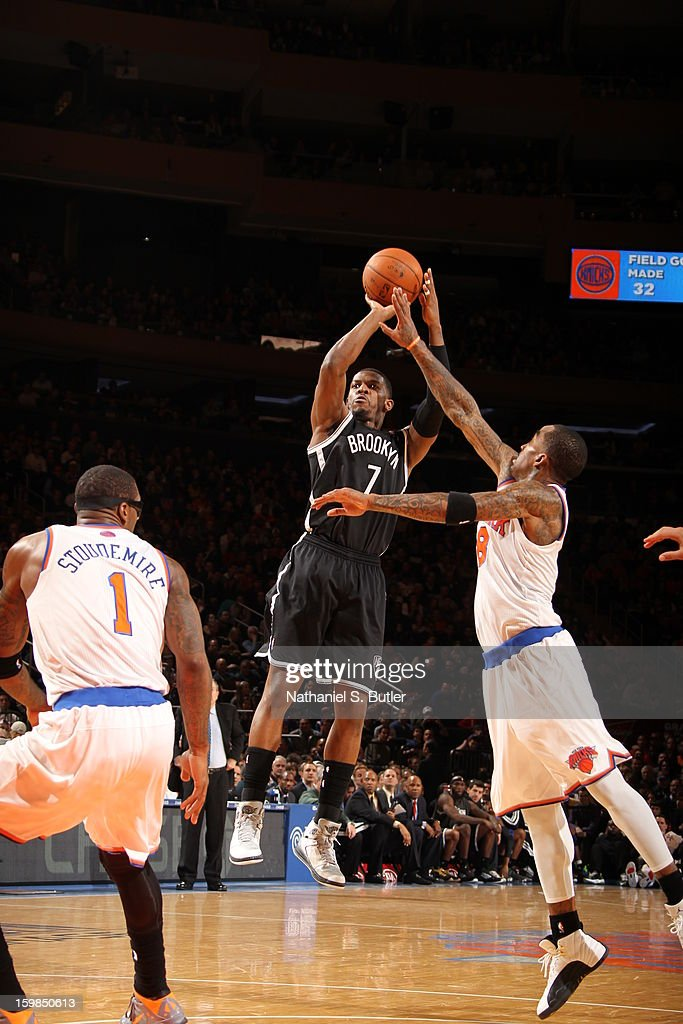 Joe Johnson #7 of the Brooklyn Nets shoots against J.R. Smith #8 of the New York Knicks on January 21, 2013 at Madison Square Garden in New York City.