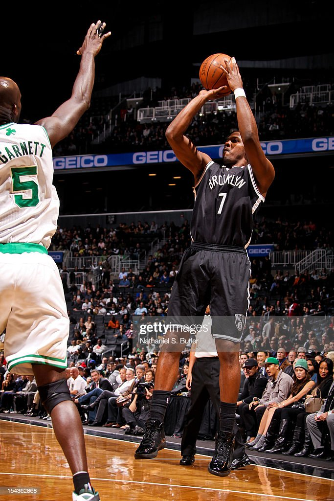 Joe Johnson #7 of the Brooklyn Nets shoots against Kevin Garnett #5 of the Boston Celtics during a pre-season game on October 18, 2012 at the Barclays Center in the Brooklyn borough of New York City.