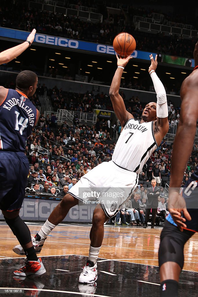 Joe Johnson #7 of the Brooklyn Nets shoots against the Charlotte Bobcats on April 6, 2013 at the Barclays Center in the Brooklyn borough of New York City.
