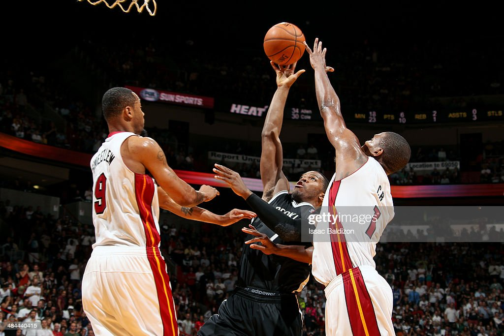 Joe Johnson #7 of the Brooklyn Nets shoots against the Miami Heat at the American Airlines Arena in Miami, Florida on April, 8 2014.