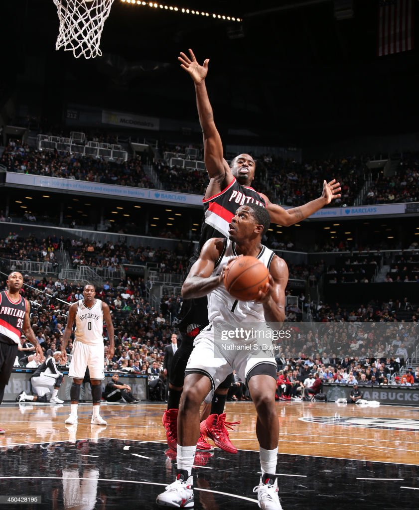Joe Johnson of the Brooklyn Nets shoots against Wesley Matthews of the Portland Trail Blazers during a game at Barclays Center on November 18 2013 in...