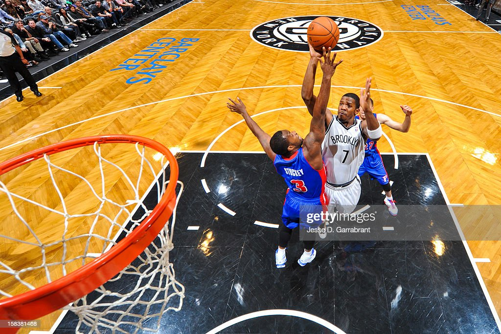 <a gi-track='captionPersonalityLinkClicked' href=/galleries/search?phrase=Joe+Johnson+-+Basketball+Player&family=editorial&specificpeople=201652 ng-click='$event.stopPropagation()'>Joe Johnson</a> #7 of the Brooklyn Nets shoots in the lane against <a gi-track='captionPersonalityLinkClicked' href=/galleries/search?phrase=Rodney+Stuckey&family=editorial&specificpeople=4375687 ng-click='$event.stopPropagation()'>Rodney Stuckey</a> #3 of the Detroit Pistons at the Barclays Center on December 14, 2012 in the Brooklyn borough of New York City.