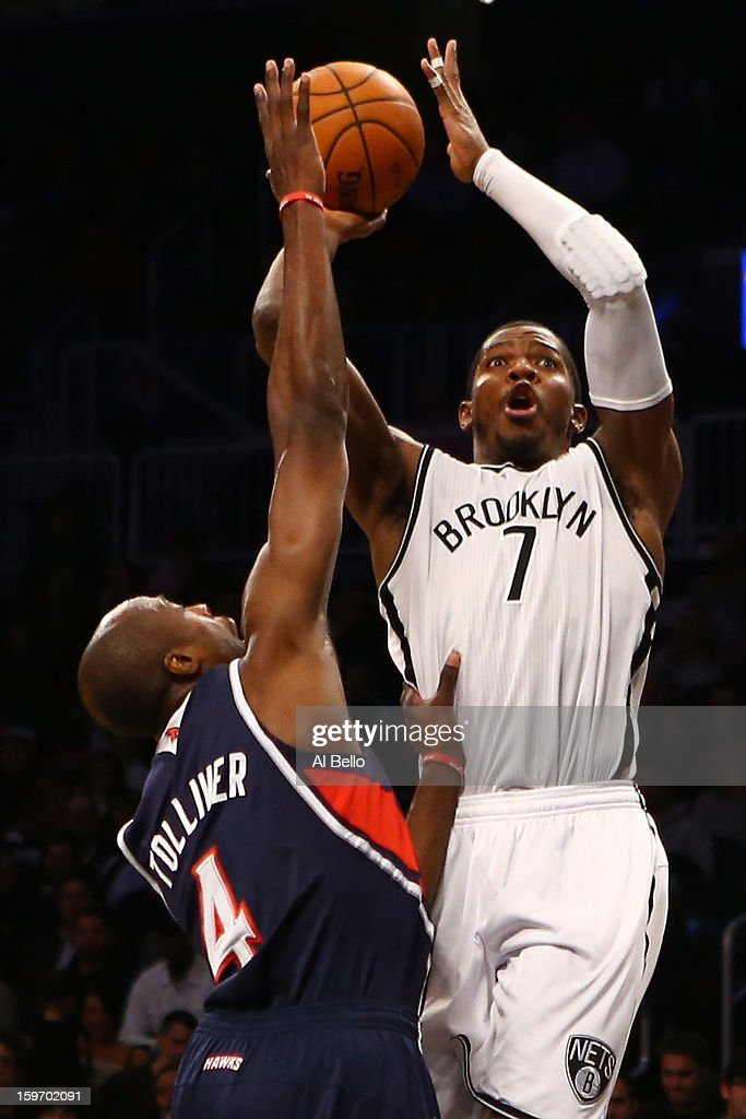 Joe Johnson #7 of the Brooklyn Nets shoots over Anthony Tolliver #4 of the Atlanta Hawks in the fourth quarter of the game at Barclays Center on January 18, 2013 in the Brooklyn borough of New York City.