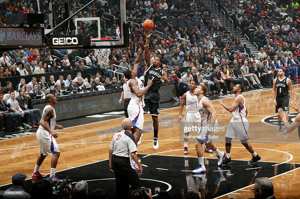 Joe Johnson #7 of the Brooklyn Nets shoots over DeAndre Jordan #6 of the Los Angeles Clippers on November 23, 2012 at the Barclays Center in the Brooklyn Borough of New York City.