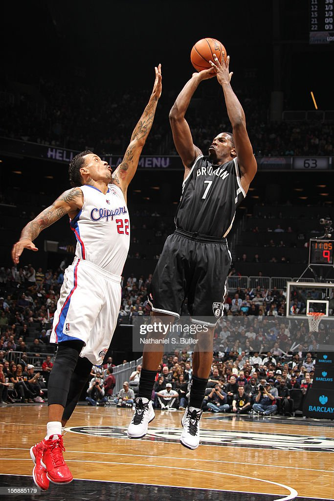 Joe Johnson #7 of the Brooklyn Nets shoots over Matt Barnes #22 of the Los Angeles Clippers on November 23, 2012 at the Barclays Center in the Brooklyn Borough of New York City.