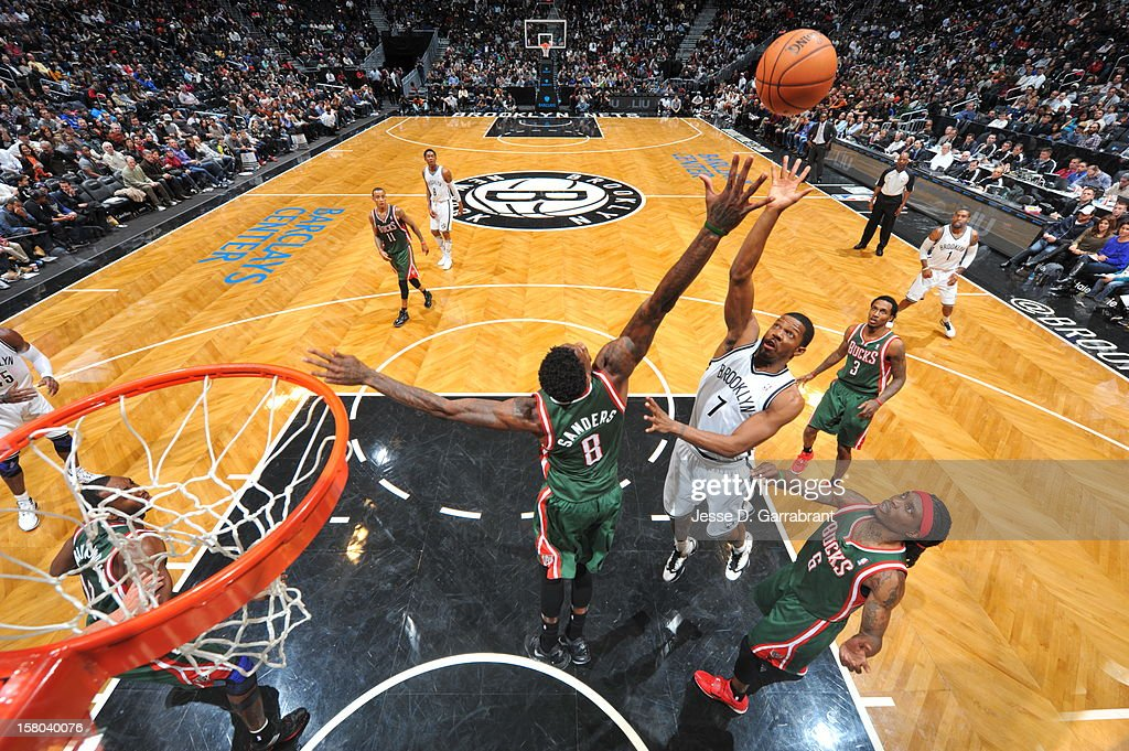 Joe Johnson #7 of the Brooklyn Nets shoots the ball against Larry Sanders #8 of the Milwaukee Bucks during the game at the Barclays Center on December 9, 2012 in Brooklyn, New York.